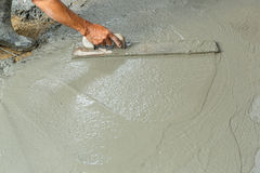Using float to level surface of concrete. Close up worker hand using float to level surface of concrete Stock Photography