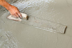 Using float to level surface of concrete Royalty Free Stock Photo