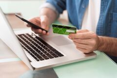 Using gadgets and bank card for e-shopping and online banking