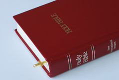 Using a golden cross as a bookmark for the bible. Using a golden cross as a bookmark for the Holy Bible Royalty Free Stock Image