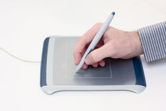 Using a graphics tablet. Image of someone using a graphics tablet Stock Photography