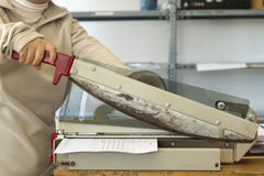 Using the guillotine in the press Stock Photos