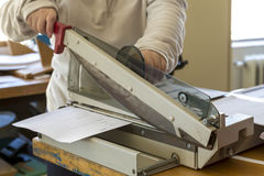 Using the guillotine in the press Stock Photography