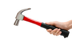Using a hammer (isolated). A hand using a red hammer on the white background Royalty Free Stock Images