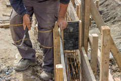 Using hammer and preparing form for concrete with reinforcing ro Stock Images