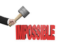 Using hammer to creak impossible 3D word Stock Photo