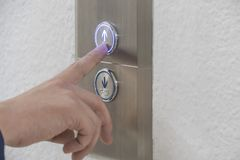Using hands, press the elevator up and keypad elevator.  Royalty Free Stock Photos