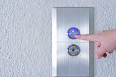 Using hands, press the elevator up and keypad elevator Stock Photo