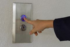 Using hands, press the elevator up and keypad elevator.  Royalty Free Stock Photo