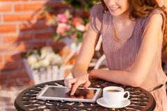 Using her brand new tablet in cafe. Stock Image