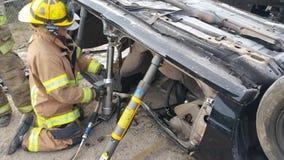 Using hydraulic tools stock image
