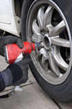 Using Impact Wrench to Change Tires Stock Image