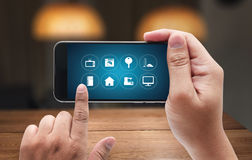 Using innovative technologies Computer System Innovation Digital. Smart house device smartphone with smart home app royalty free stock image