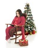 Using an Ipad at Christmastime Royalty Free Stock Image