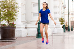 Using a jump rope in the city royalty free stock image