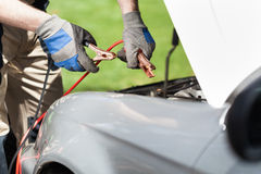 Using jumper cables. To start a car battery Stock Images