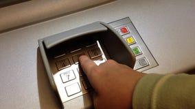 Using keypad at ATM machine Stock Image