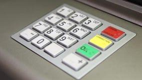 Using keypad at ATM machine Stock Photo