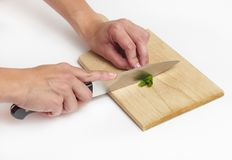 Using kitchen knife to cut Royalty Free Stock Image