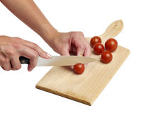 Using kitchen knife to cut tomato royalty free stock images