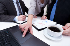 Using laptop on business meeting Stock Photography