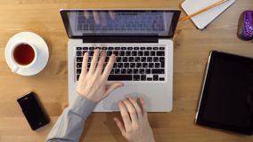 Using Laptop at the Desktop stock footage