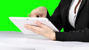 Using laptop. Green screen. Using laptop, person in formal suit sitting at the table and uses laptop, white laptop, pc, official view, business theme, young man stock video footage