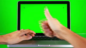 Using Laptop with Green Screen stock video footage