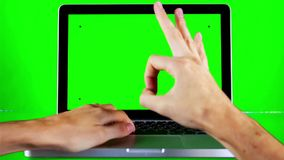 Using Laptop with Green Screen. Using laptop with a green screen with various hand gestures  on a green background stock video