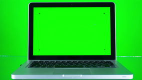 Using Laptop with Green Screen. Using laptop with a green screen with various hand gestures  on a green background stock footage