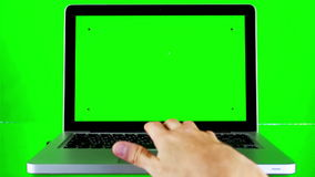 Using Laptop with Green Screen stock video