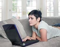 Using laptop at home Stock Image