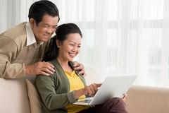 Using laptop at home Stock Photo