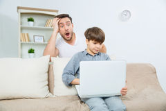 Using laptop is pretty much easy Royalty Free Stock Photos