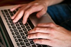 Using laptop for researching, gaming and comunication royalty free stock photo