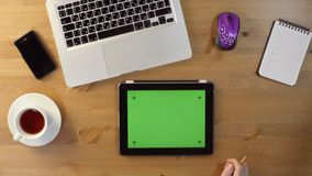 Using Laptop and Tablet PC with a Green Screen. At the Desktop.Top View stock video
