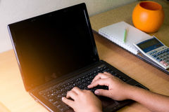 Using laptops. Women are using laptops. By hand typing on the keyboard Stock Images