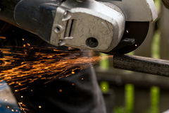 Using Of Machine For Grinding Metal Close Up. Outdoor Royalty Free Stock Image