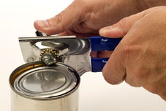 Using Manual Can Opener Royalty Free Stock Photos