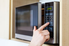 Using Microwave Oven Royalty Free Stock Photos
