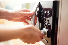 Using microwave oven, close up photo Royalty Free Stock Images