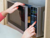 Using microwave oven Stock Photography