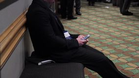 Using a mobile device in the hallway stock video footage