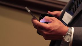 Using a mobile device at a meeting (5 of 5). A view or scene of Technology stock footage