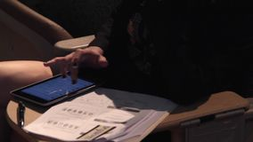 Using a mobile device at a meeting (2 of 5). A view or scene of Technology stock video footage