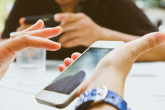 Using mobile devices. Group of people using mobile devices stock image