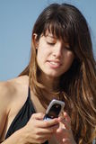 Using a mobile phone. A young woman in a bikini using mobile phone Stock Images