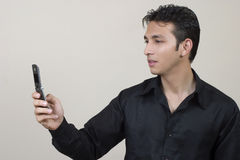 Using mobile phone. Young indian using  mobile phone Royalty Free Stock Photos