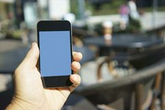 Using mobile phone in a cafe Stock Photos