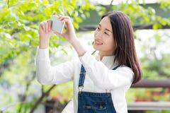 Using a mobile phone camera Stock Photos